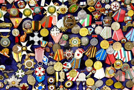 Badges collection stock photo, Old badges collection in antique shop by Desislava Dimitrova