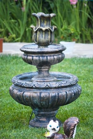 Fountain garden decorative statue stock photo, Fountain garden decorative statue on green grass by Desislava Dimitrova