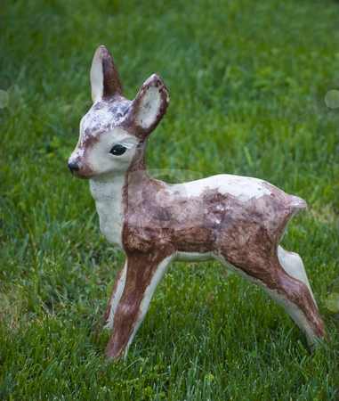 Garden decorative statue stock photo, Little deer garden decorative statue on green grass by Desislava Dimitrova