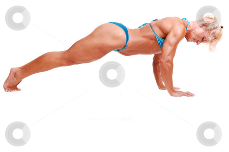 Woman doing pushups. stock photo, A blond muscular woman doing pushups on the floor of the studio, in an  blue tiny bikini, lifting her butt up, for white background. by Horst Petzold