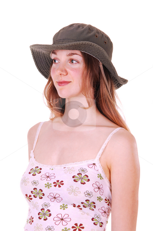 Young lady with hat. stock photo, Beautiful young woman in a pink dress and an fabric hat smiling and looking away from the camera, on white background. by Horst Petzold