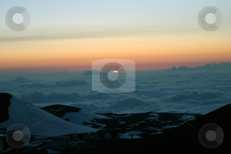 Top of Mt Mauna Kea sunset stock photo, A beautiful sunset on top of Mauna Kea looking down on a sea of clouds by Sharron Schiefelbein