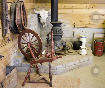 229 Old spinning wheel stock photo, Spinning wheel, potbelly stove and other antiques by Sharron Schiefelbein