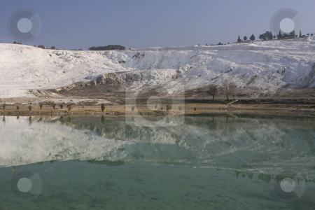378 Pamukkale in Central Turkey stock photo, White terraces at Pamukkale next to Hierapolis.  Hot springs flows down slope leaving limestone steps by Sharron Schiefelbein