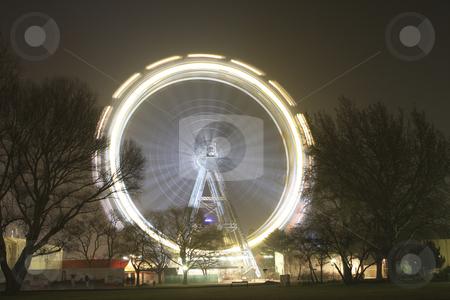 Giant Ferris wheel Riesenrad at going around stock photo, Riesenrad giant ferris wheel is over 100 years old. by Sharron Schiefelbein