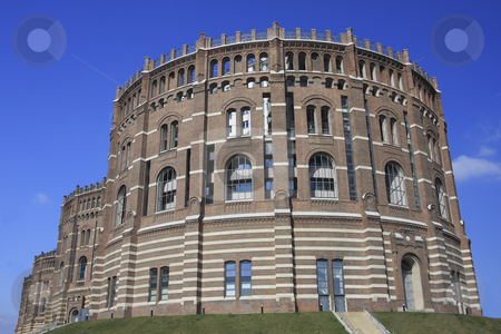 Gasometer in Vienna stock photo, These round shaped buildings built in 1899 were used as to store gas.  There are new buildings inside the old ones. by Sharron Schiefelbein