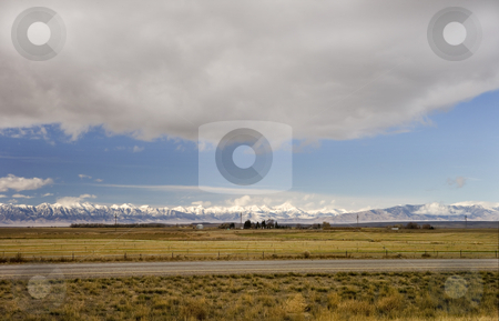 410 Dark clouds over a farm stock photo, Landscape of snowcapped mountain with farm in front by Sharron Schiefelbein