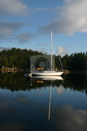 Sail boat on West coast of BC Canada stock photo, Sail boat anchored in a small bay on the West coast of BC Canada by Sharron Schiefelbein