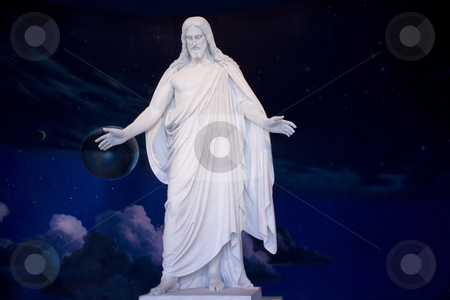 Statue of Jesus Christ in the Salt Lake Temple  stock photo, Jesus standing with the Universe behind him.  Stars and planets by Sharron Schiefelbein