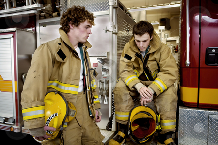 82 Two young Firemen stock photo, Waiting for the debriefing after a large fire. by Sharron Schiefelbein