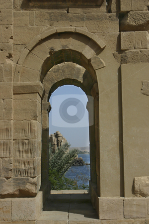 Arch looking onto the Nile stock photo, An Arch in Philae Temple on the Nile in Egypt. Look close at the long indents in the wall where the Roman soldiers sharpened their swords. by Sharron Schiefelbein