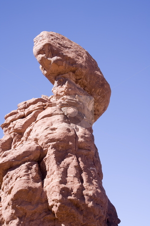 Balanced Rock in Arches National Park Utah stock photo, Very large rock balanced on top of a rock pillar. Looks like it could fall at any time. by Sharron Schiefelbein