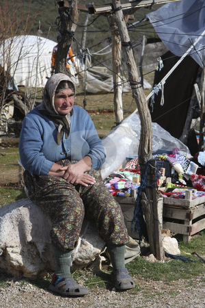 Nomadic woman  stock photo, Nomadic woman selling her hand made goods by Sharron Schiefelbein