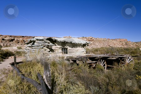 Days gone by with old homestead and wagon stock photo, Old Homestead and wagon in Arches National Park Utah by Sharron Schiefelbein