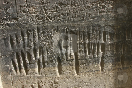Wall where Roman soldiers sharpened their swords. stock photo, A wall in Philae Temple on the Nile in Egypt. Look close at the long indents in the wall where the Roman soldiers sharpened their swords. by Sharron Schiefelbein