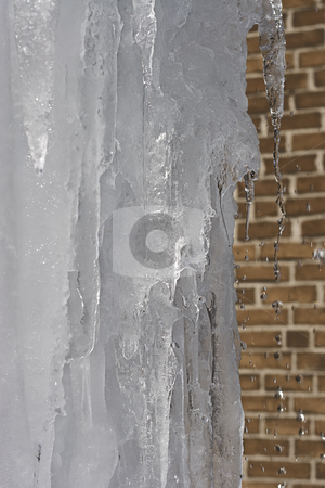 Melting ice stock photo, Big chunk of ice in the process of melting by Yann Poirier