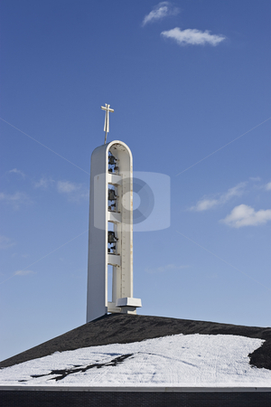 Church bell stock photo, Church bell tower against a blue sky during winter by Yann Poirier