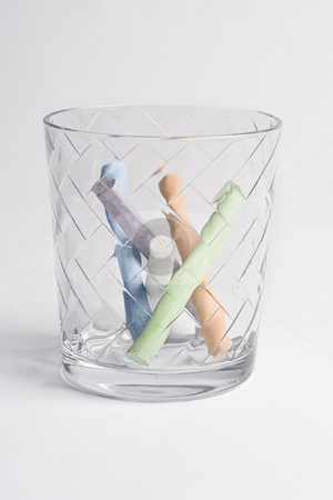 Glass of chalk stock photo, Etch glass containing colored chalk by Yann Poirier
