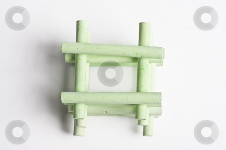 Stack of chalk stock photo, Green chalk stack in a manner to create a house by Yann Poirier
