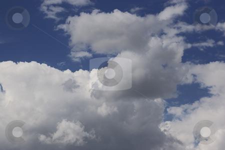 Stormy weather stock photo, Dark cloud formation on blue sky by Yann Poirier