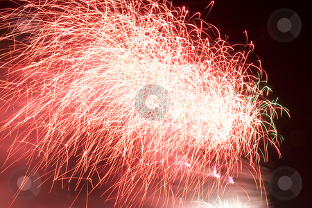 Firework stock photo, Red firework display trailing in the wind by Yann Poirier