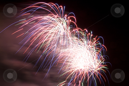 Firework stock photo, Multi-colored firework display trailing in the wind by Yann Poirier