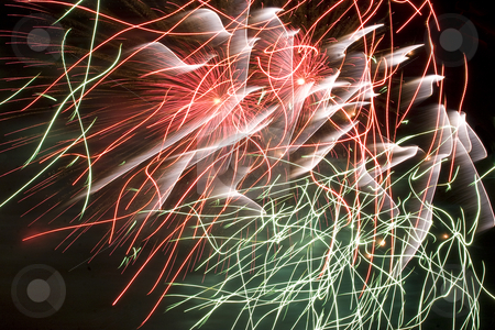 Firework stock photo, Red,green and white erratic firework display trailing in the wind by Yann Poirier
