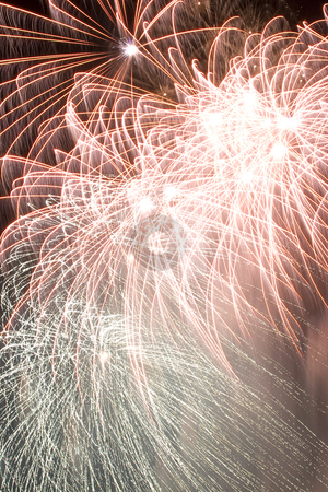 Firework stock photo, Red and green firework display trailing in the wind by Yann Poirier