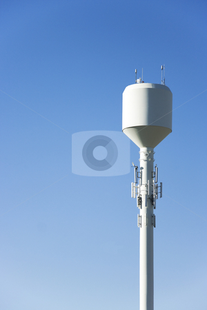 Water Tower stock photo, A white water tower with plenty of sky for copyspace by Kevin Tietz