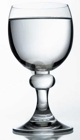 Isolated red wine glass stock photo, Isolated red wine glass filled with water by Yann Poirier