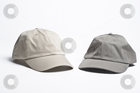 Baseball caps stock photo, Two plain beige baseball caps of different tint by Yann Poirier