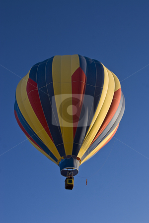 Multi-colored hot air ballon stock photo, Early morning lift off a multi-coloured hot air ballon by Yann Poirier