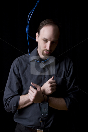 SUICIDAL TECHNICIAN  stock photo, Computer technician with tied hands and hangman noeuce done with network blue cable around his neck by Yann Poirier