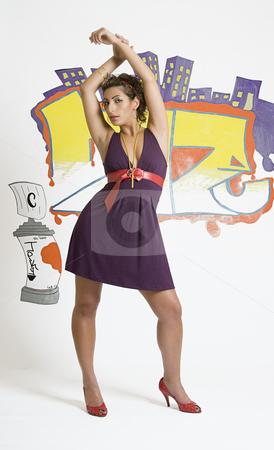 Street fashion stock photo, Fashion model posing in front of a graffiti by Yann Poirier