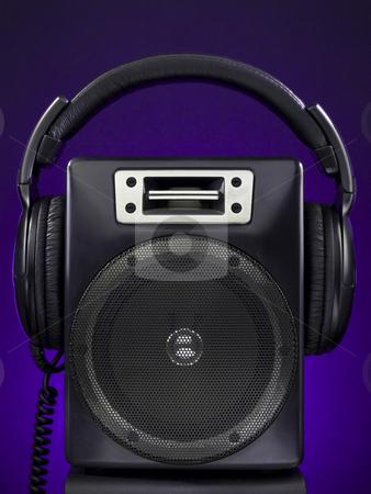 Speaker and headphone set stock photo, A speaker and a headphone set over a purple background. by Ignacio Gonzalez Prado