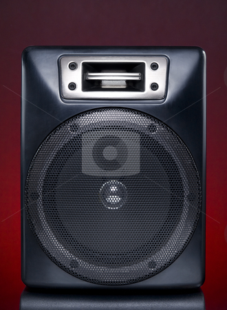 Black speaker stock photo, A black speaker over a red background. by Ignacio Gonzalez Prado
