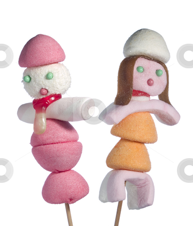 Candy people stock photo, A male and a female figurin made out of candies on a stik over a white background. by Ignacio Gonzalez Prado