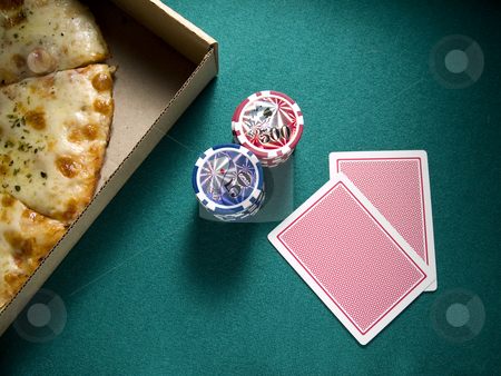 Poker with friends stock photo, Two cards, two piles of chips and a box of pizza over a green felt. by Ignacio Gonzalez Prado