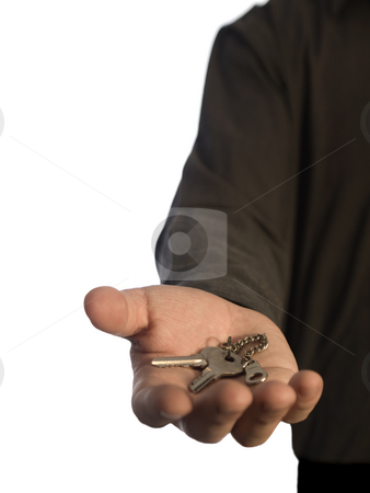 Man holding keys stock photo, A man holding a pair of keys on his hand over a white background. by Ignacio Gonzalez Prado