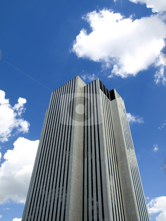 New York building stock photo, High modern skyscraper on a background of a blue sky and clouds. by Ignacio Gonzalez Prado
