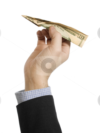 Fly away stock photo, A man's hand about to throw a paper plane made of a ten dollar bill. by Ignacio Gonzalez Prado