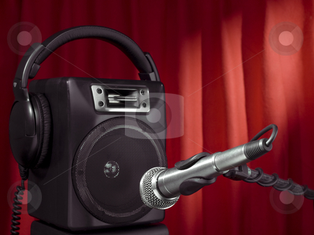 Singer speaker stock photo, Professional microphone, headphone and speaker with a red curtain on the background. by Ignacio Gonzalez Prado