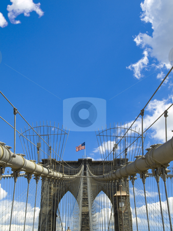 Brooklyn bridge stock photo, A view of the Brooklyn bridge with a blue sky on the background. by Ignacio Gonzalez Prado