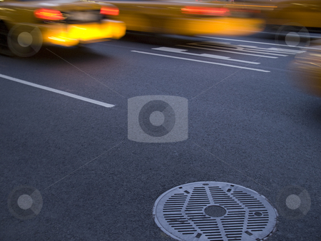 Streets of New York stock photo, Several New York yellow cab running beside a culvert. by Ignacio Gonzalez Prado