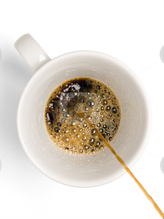 Coffee stock photo, Fresh coffee being poured into a coffee cup on a white background. by Ignacio Gonzalez Prado