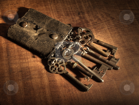 Old keyring and keys stock photo, An old leather keyring over a wooden table. by Ignacio Gonzalez Prado