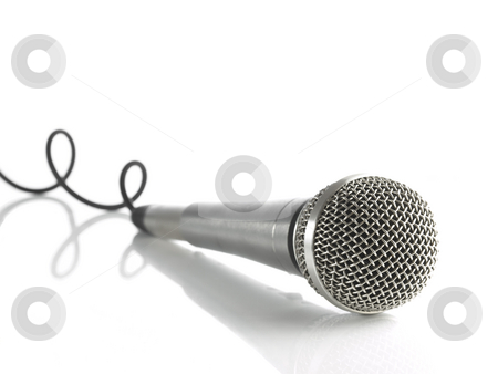 Mic with curled cable stock photo, A dynamic mic with a curled cable over white. by Ignacio Gonzalez Prado