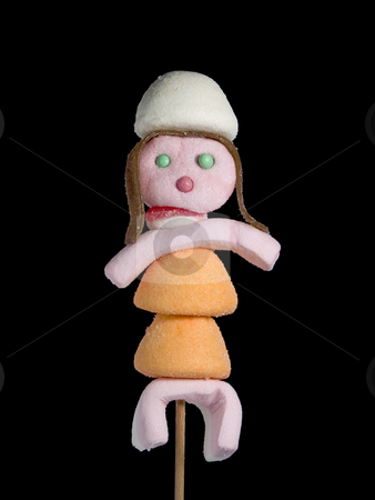 Candy people stock photo, A female figurin made out of candies on a stik over a black background. by Ignacio Gonzalez Prado