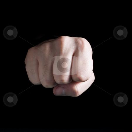Fist stock photo, A male?s fist isolated on black background. by Ignacio Gonzalez Prado