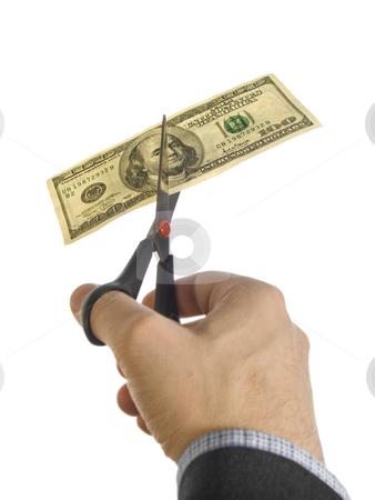 Cut the bill stock photo, A man's hand cutting a one hundred dollar bill with a pair of scissors. by Ignacio Gonzalez Prado